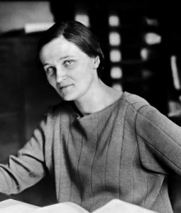 B/W portrait of Cecilia Payne-Gaposchkin sitting at a desk