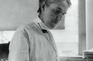 B/W photo of Henrietta Swan Leavitt at work